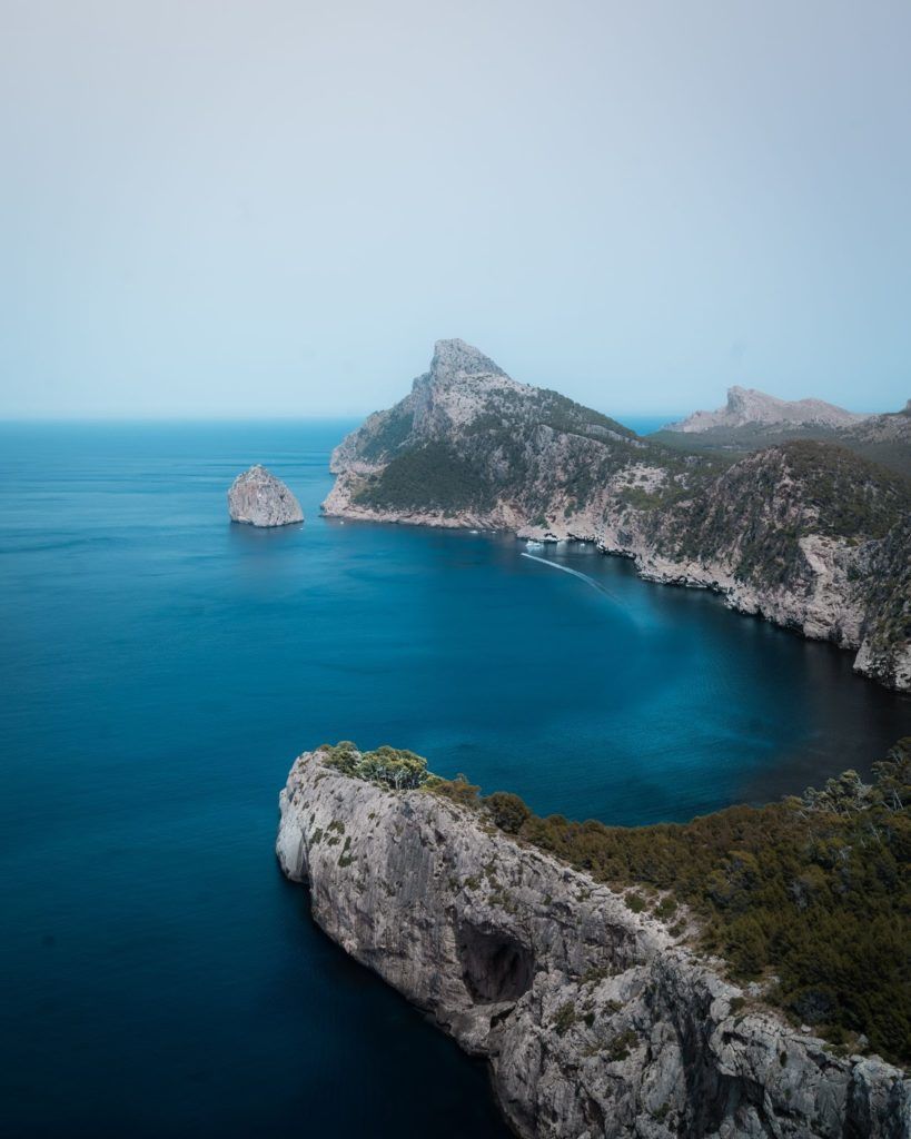 blue sea and cliffs. remote working from spain